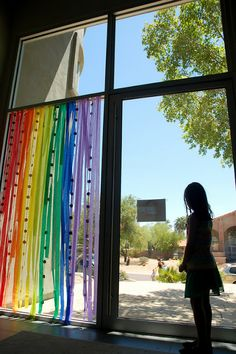 Rainbow streamers greet guests to the rainbow birthday party