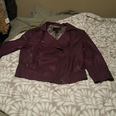Purple Faux Leather Jacket Purple faux leather jacket with silver lining. The body is full length with 3/4 length sleeves. It has zipper detailing on the body and sleeves, with 2 usable pockets.  Can fit a size small as well. Excellent condition. Daytrip Jackets & Coats