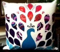 Proud Peacock Pillow: Capture the elegance of one of nature's most beautiful creatures with some simply applique quilt designs that you'll arrange to make exquisite pillow designs.