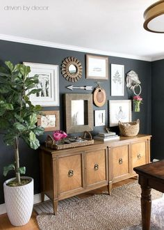 A faux fiddle leaf fig tree from HomeGoods (it looks so real!) adds fresh color and life to this eclectic gallery wall (sponsored pin)