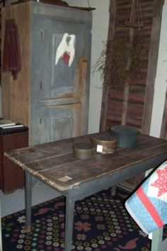 Love the primitive plank top style of this table.