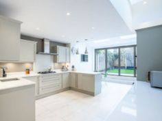 When this customer realized that upgrading to a larger home is unfeasible they decided to transform their pretty Victorian cottage in Teddington into the space they craved. Victorian Cottage, Large Homes, Lofts, Extensions, Bob, Kitchen Cabinets, Home Decor, Loft Room, Loft