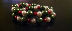 Red, White, and Dark Green Medium Memory Wire Bracelet. Please visit my facebook page called The Pelican By Kristin Margarite. https://www.facebook.com/ThePelicanbyKristin/?ref=aymt_homepage_pane