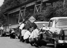 """July 23, 1959: The Battle of Chicken Hill - one of Pittsburgh's most famous bank robberies. This happened in Hays on a hot, muggy day in 1959, when Pittsburgh was in its industrial prime. An """"iodine colored"""" sky hovered over the city, the Post-Gazette later reported."""