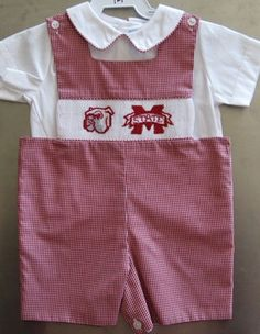 Maroon and White gingham Jon Jon is hand smocked with the new Bully head and M-State logos.
