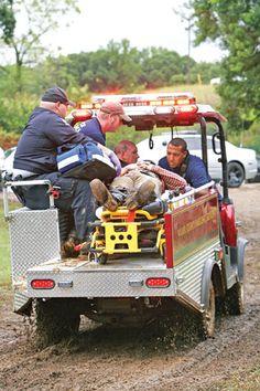 First responders transport a reenactor to an ambulance after he and his horse fell from a bridge. (Messenger photo/Matt Ledger)