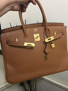 The cost of Hermes handbags Birkin is extremely high because of the labor cost involved in manufacturing. Only one craftsman can work on one handbag and it takes about 48 hours to come up a single Birkin bag. Another major factor of this bag is the rare materials used. Leather used for the preparation of the bag is treated before using.