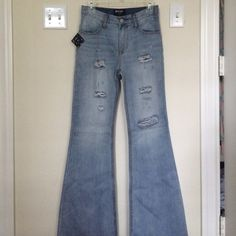Nasty Gal High Rise Destroyed Flare Jeans brand new with tags / never before worn. in a size 26 - fits true to size. Nasty Gal Jeans Flare & Wide Leg