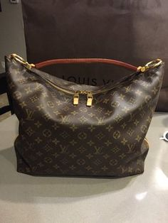 Louis Vuitton Sully Hobo Bag. Hobo bags are hot this season! The Louis Vuitton Sully Hobo Bag is a top 10 member favorite on Tradesy. Get yours before they're sold out!