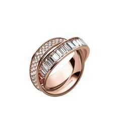 Some pieces are everlasting, like our glamorous eternity ring, featuring two entwined rose gold-tone bands and row upon row of pavé stones. Both elegant and unexpected, it's a unique piece that's timeless, but also feels fresh and artful. Wear this one-of-a-kind sparkler on its own, or up the drama and surround it with delicate stacking rings.