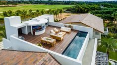 The rooftop terrace features a contemporary outdoor living space, dining room an. The rooftop terr Roof Terrace Design, Rooftop Design, Rooftop Terrace, Terrace Floor, Terrace Garden, Swimming Pool Designs, Pool Houses, Modern House Design, House Plans
