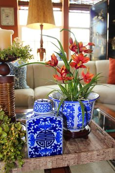 Blue and white with orange, a beautiful combo!! Bring in seasonal color with flowering plants from each season.