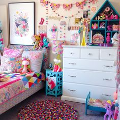 Isla's Liberty Rainbow Bedroom via Rhapsody and Thread / Liberty lampshade, bow garland, dolls bedding, patchwork cushion and quilt by Rhapsody and Thread. Felt ball rug by Little Rosie and Me. Unicorn banner by Little Olive and Co. Helen Dardik print.