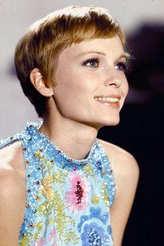Mia Farrow wearing dress designed by Pierre Cardin.