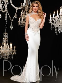 This glamorous Panoply pageant dress will bring elegance and beauty to any pageant stage. This beaded tulle Panoply pageant gown 44272 features an illusion collar, cap sleeves, and gorgeous sweetheart fitted bodice. A matte jersey trumpet skirt completes this Panoply pageant gown. The back train godet inset scattered with rhinestone lace adds a perfect finishing touch to this Panoply pageant dress. Features:  Silhouette: Trumpet  Neckline: Sweetheart  Available in sizes 0 through 16…