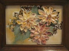 Vintage seashell art flowers in frame