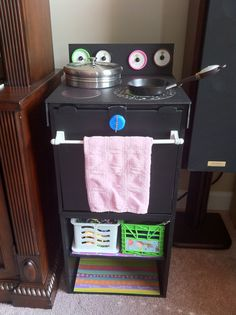 "Children's Oven! Plastic shelf as a base. Foam board cut and hot glued, scrapbook paper for burners. <-- top can be removed when the ""stove"" is not needed. Also has storage under ""oven."""