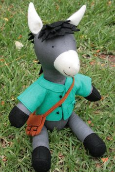 Reuben the Donkey: Donkey pattern, donkey PDF pattern, donkey plush, donkey toy, donkey with clothes, sewing pattern  Reuben stands 14 ½ inches (37cms) tall which is pretty tall for a small bilingual donkey. Reuben has the cutest little removable jacket with button tabs on the back and the pocket. His little school satchel opens up to carry his treasures.  You will need :   1 fat quarter 100% cotton for donkey body  12 x 10 inch (31 x 26 cm) black wool felt  9 x 4 inch (23 x 10 cm ) white…