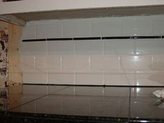 Black Countertop With White Subway Tile