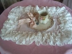 lovely ruffles place mate and tea serving