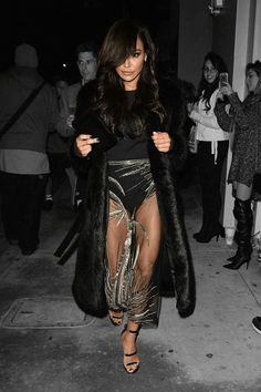 """Naya Rivera just took the term """"showing a little leg"""" to new levels.  The actress was seen at the premiere party for her new film,Mad Families —in Los Angeles at Catch restaurant — showing off some major skin in a look that can't seem to decide whether it's for cold or warm weather.  Naya Rivera was"""
