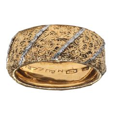 BUCCELLATI ; Designed as a textured gold band,mounted in 18k white and yellow gold Size 7, in a Mario Buccellati blue leather case Signed M. Buccellati for Mario Buccellati, Italy