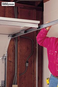 Check out these expert tips for easier installation of a replacement garage door opener and trouble-free operation. Garage Door Rails, Garage Door Springs, Garage Door Makeover, Garage House, Garage Door Opener Installation, Garage Door Opener Repair, Garage Door Replacement, Track Door, Hanging Rail