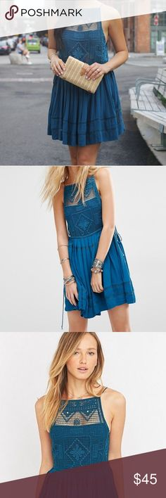 Free People Emily Crochet Tie Boho Dress blue xs Free People Emily Crochet Tie Boho Dress in gorgeous blue! Featuring a crochet bodice this super femme mini dress has pleat detailing on the skirt and adjustable ties at the waistband. Skirt and front part of the bust are lined. 100% Rayon. GUC. Free People Dresses Mini
