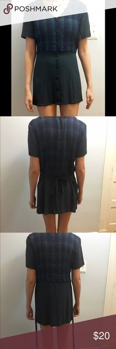 """Vintage Plaid Mini Dress Vintage 80s dress with buttons down the front. The tie in the back makes it more form fitting. Vintage size 8, so it translates to a size 4. It is very short! I'm 5'7"""" and it goes right below my butt, wayy too short for me.   ***   ***   ***   ***   *** • NO SWAPS • Please message me with any and all inquiries • MAKE ME AN OFFER! I'll most likely except it, but please no low-balling • Discounts on bundles! • Smoke-free house • No returns  :) Vintage Dresses Mini"""