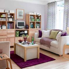 Beautiful Small Living Room Inspiration With Cute Cushions On White Sofa Set And Lovely Purple Carpet Area And Wooden Floor Also Good-looking Curtain And Bookcase