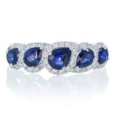 Wedding band, anniversary band, this sapphire ring will fit the occasion. A fine 18 karat white gold, featuring natural exquisite royal blue pear cut sapphire, the birthstone of September. This sapphire band can compliment your engagement ring, also celebrate your anniversary, a great gift idea.