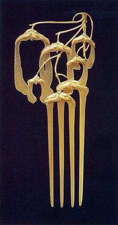 Hair comb by Rene Lalique, ca.1902. Horn, topaz, diamond, and gold