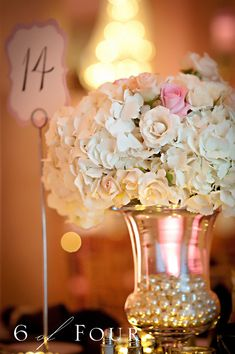 Floral centerpiece with faux pearl vase filler.