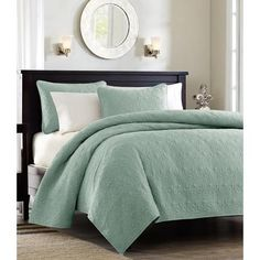 Classic sea foam green quilt great for layering with your existing bed linens, but just as superb by itself. Reminiscent of matelasse linens, our coverlet is quilt stitched in a lovely scroll pattern,