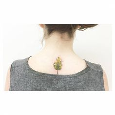 Little watercolor style tree on the upper back. Tattoo artist:...