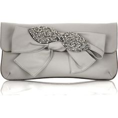 Leather bow-embellished clutch ($767) ❤ liked on Polyvore