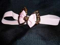 For most of the party she wore her trademark headbow.  This pink/leopard was provided by one of my favorite vendors www.thebowlady.com