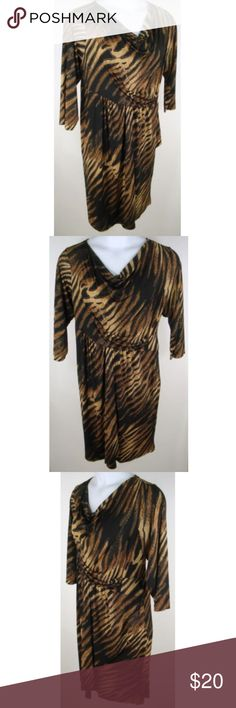 "Dress Stretch Animal Print Metallic Fluid Jersey * New With Tag * No rips, stains, tears or other signs of shop/shelf wear Retail Priced at: $59.90  Tagged as Size 18/20  Black and Brown with Gold Metallic  Bust Measures 46"" Waist Measures 44"" Hips Measure 51"" Shoulders Measure 17"" Sleeves Measure 18½""  Length Measures 40""  Hem Measures 56""   Comfortable, lightweight and stretchy jersey knit fabric Draped neckline ¾ length sleeves Mock wrap front Back bodice darts for a flattering fit  95%…"