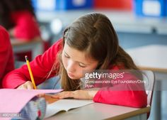 Stock Photo : Student writing in classroom
