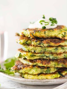 Recipe video above. Zucchini fritters made extra crispy and extra tasty with the addition of parmesan! Crispy on the outside, and moist but not soggy on the inside. Love how these are light on batter Zucchini Zoodles, Zucchini Chips, Vegan Zucchini Fritters, Zucchini Patties, Veggie Fritters, Squash Fritters, Broccoli Fritters, Zucchini Bites, Zucchini Bread
