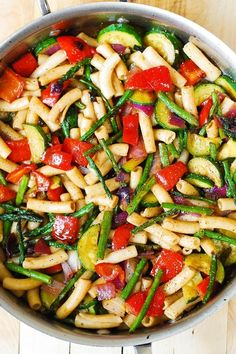 Pasta salad is a common potluck favorite or summer side dish, but this delicious pasta salad with roasted vegetables is actually one of our favorite healthy dinner recipes for the season. It's easy to make and combines delicious vegetables like zucchini and asparagus.