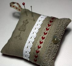 Pincushion, - Natural Linen Fabric, Cotton Lace, Red Trim, Mother of Pearl Button - RUSTIC RED. $12.00, via Etsy.