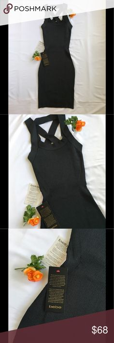 Bebe Strappy Bodycon Midi Dress NWT! Both sexy and elegant, this dress is a real head-turner with its form-fitting design. The third photo is the best representation of color - I would describe it as a dark charcoal gray. The ribbed fabric has beautiful luster and a high-quality feel. 84% Rayon, 14% Nylon, 2% Spandex bebe Dresses Midi