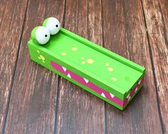 Turn an unfinished box into a fun alligator pencil case! Cute, fun to display, and perfect for back to school organizing!