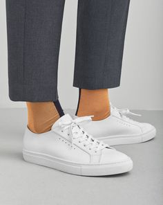 Classic sneaker in cow nappa. White soles and colour insert bottom for both  versions. Calf leather lining and insock.