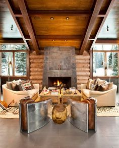 love the modern/rustic fireplace.  beautiful cream couches