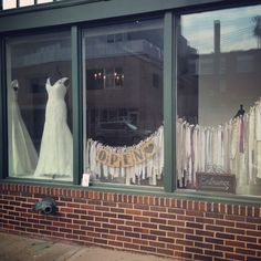 Opening window display at Something White Bridal Boutique.