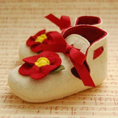cream felt with red flower available in infant sizes 1-3