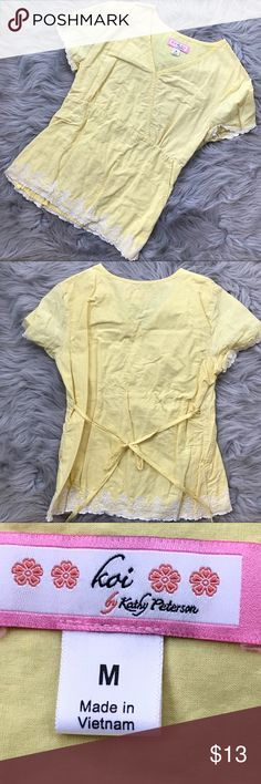 Koi- yellow/white M Scrub Top Koi- yellow/white M Scrub Top - in excellent condition- -I'm having to go to a solid color at work- so my loss is your gain.  Comes from a smoke free home.  Thanks for shopping my closet and remember to bundle to save on shipping. Tops
