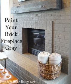 Gray Painted Brick Fireplace. Paint your brick fireplace gray! Found at www.providenthomedesign.com.